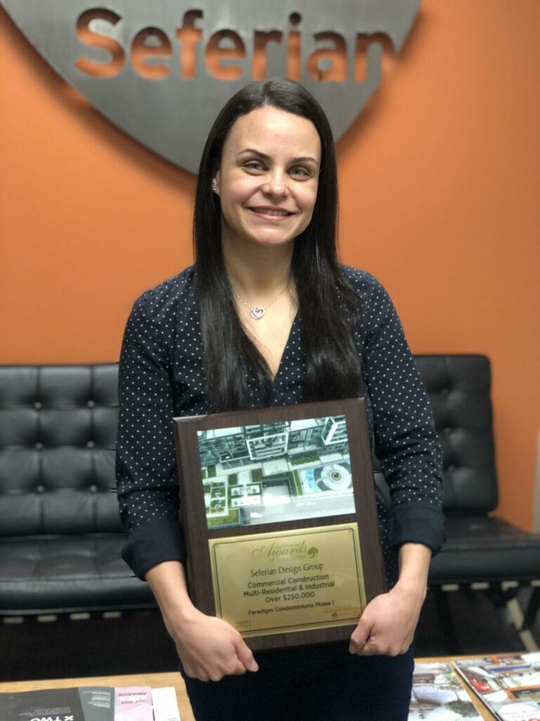 Carolina holding LO award plaque for Paradigm Phase 1