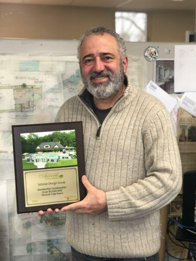 Haig Seferian holding LO award plaque